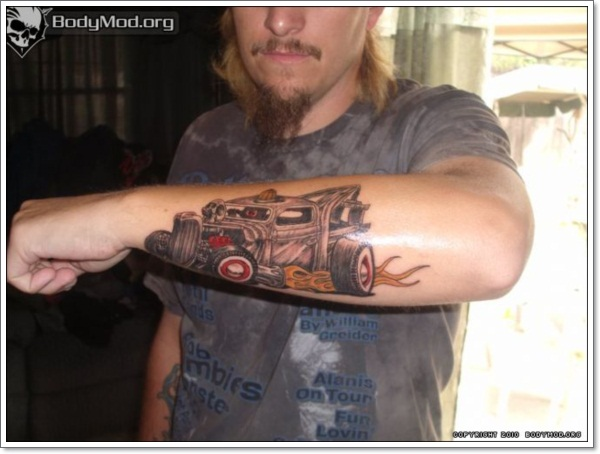 man-with-colored-ink-car-tattoo