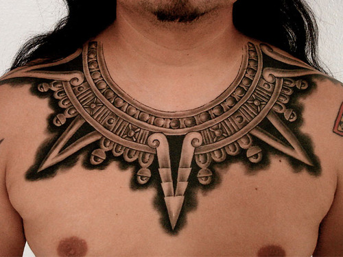 This-tattoo-collar-decorates-this-guys-neck-and-chest-with-tribal-Aztec-architectural-elements