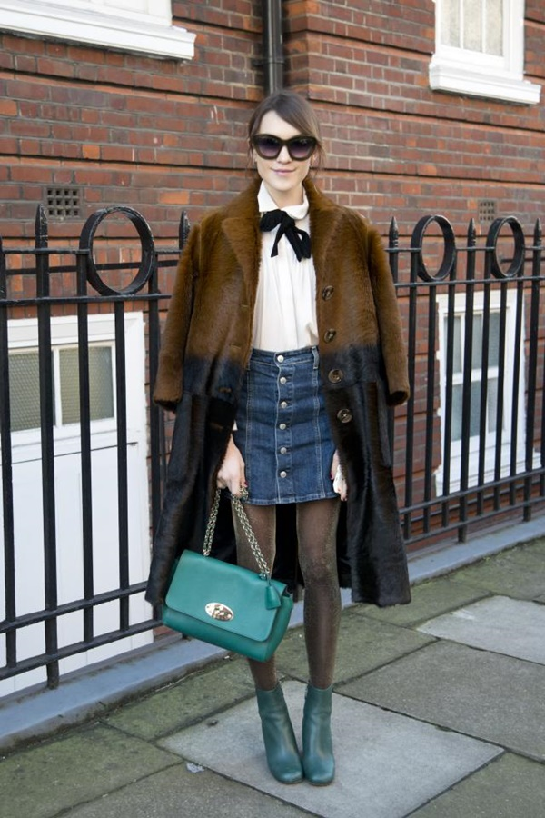 LONDON, ENGLAND - FEBRUARY 23: Fashion blogger Ella Catliff wears a Burberry coat, Mulberry bag and boots, Maje shirt, Alexa Chung for AG Jeans and Kirk Originals sunglasses on February 23, 2015 in London, England.  (Photo by Kirstin Sinclair/Getty Images)